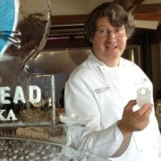 Nick Hartmann with Cathead Vodka ice sculpture